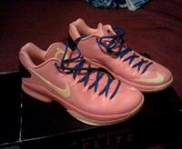 pair of pink-and-white Nike running shoes Lancaster, 93534