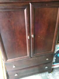 Brown Television armoire with drawer