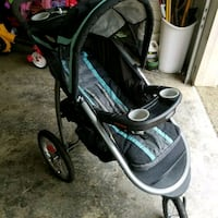 baby's black and green jogging stroller 3158 km