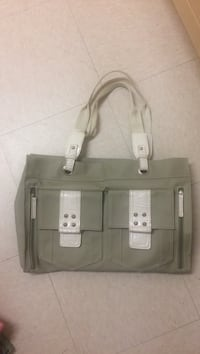women's gray and white hand bag