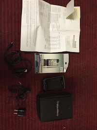 Older Blackberry with charger and case Toronto