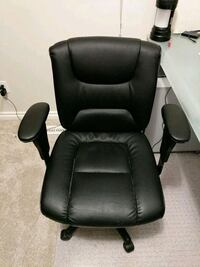 black leather padded rolling office chair Edmonton, T5P 1P6