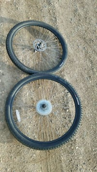 two black bicycle wheels with tires Fargo