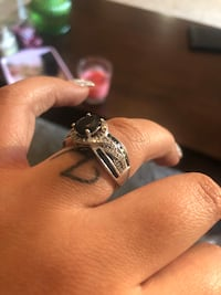 silver-colored black gemstone ring