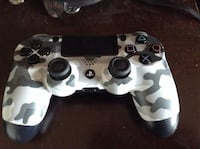white and black camouflage Sony PS4 controller
