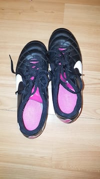pair of black-and-pink Nike sneakers