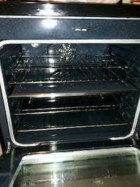 black and gray gas range oven 52 km