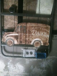 Antique metal Dairy truck sign guess who by the de Kansas City, 66106