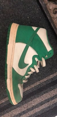 Green and white nike textile.