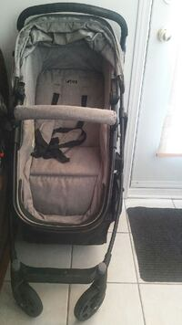 baby's gray and black stroller