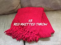 red knitted throw fringe blanket