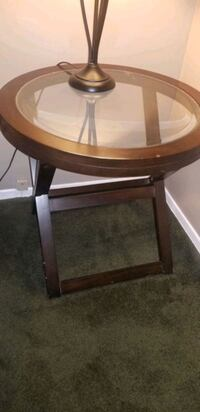 Small end table. Dark wood with glass