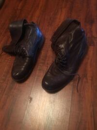 Pair of black leather shoes Houston, 77096