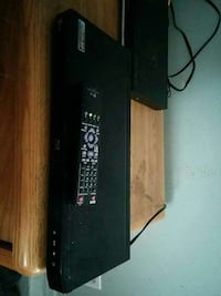 black DVD player with remote controller