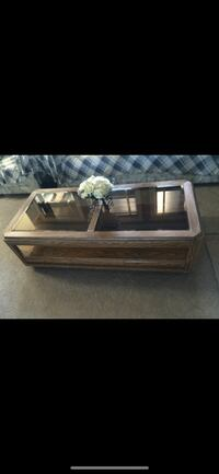 rectangular brown wooden framed glass top coffee table North Cowichan, V9L