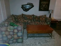 Couch, coffee table, and side table on the right. 2251 mi