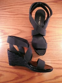 pair of black leather open-toe wedges Toronto, M6L 1A4