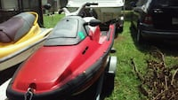 red and black personal watercraft Pensacola, 32507