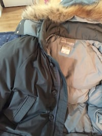 gray and brown North Country fur-lined parka jacket