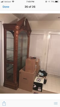 brown wooden framed glass display cabinet Fayetteville, 28306