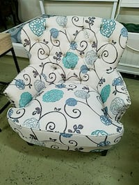 tufted white, black, and teal floral sofa chair