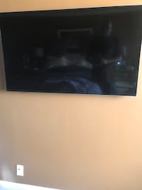 black flat screen TV with remote Baltimore, 21210