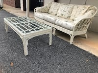 White wicker couch and matching glass top coffee table Rockville