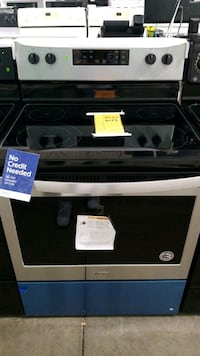 New whirlpool glass top electric Stove 30inches. Queens