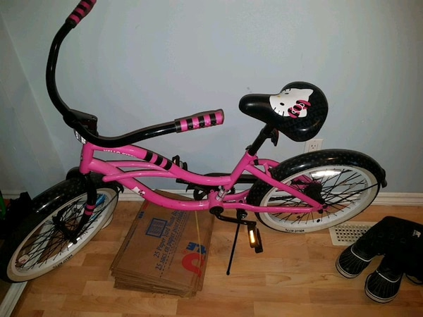 pink and black Hello Kitty bicycle