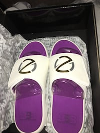 white-and-purple slide sandals