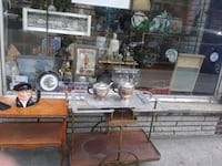 brown wooden framed glass top table Montreal, H8R 1E2
