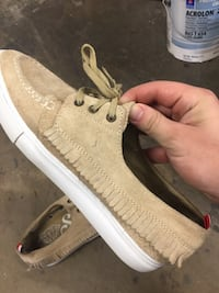 pair of beige suede boat shoes