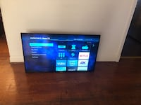 black flat screen TV with remote Baltimore, 21215