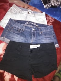 three blue, black, and white denim shorts Calgary