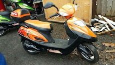 orange and black electric scooter