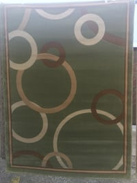 Green and beige 5x7 area rug Jacksonville, 32216