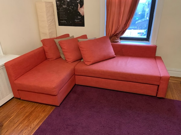 Orange sectional sofa (converts into Queen sized bed) with throw ...