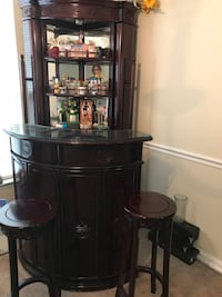 Rosewood Corner Bar with 2 pullout shelves on either side and glass topped bar and 2 bar stools . Clinton, 20735