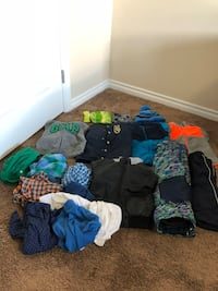 Baby's assorted clothes 3 hats ,5 winter jacket and 2 snow pants 1 pajama and 7 shirt good for kids 2 to 3 years old just like new  Edmonton, T6T 0M3