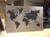 gray and black wooden map wall decor