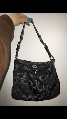 Black and gray Coach monogram leather baguette bag