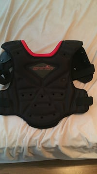 Red and black chest protector for motto crossing