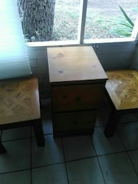 two brown wooden side tables and 2-drawer chest