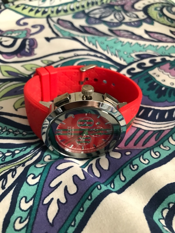 silver face gucci chronograph watch with red rubber strap