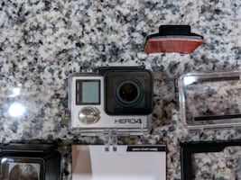 GoPro Hero4 Black with 64GB high speed Micro SD card and accessories