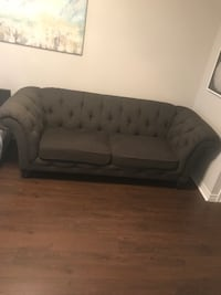 tufted black leather 2-seat sofa