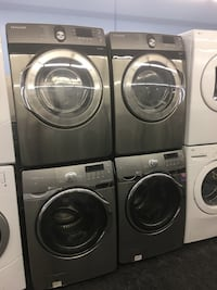 black front-load clothes washer and dryer set 549 km