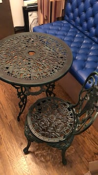 round black metal framed glass-top table New York, 10003