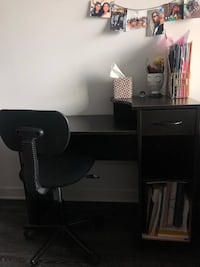 Black wooden desk with black office chair with wheels  Arlington, 22201