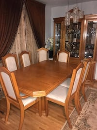 7 chairs  dining room table  and hutch set